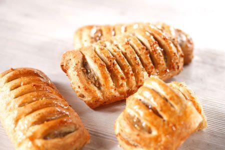 Tiefkühl Plundergebäck Gastronomie: Die Nusstasche Premium mit ihrer saftigen Füllung und dem feinen Plunderteig ist ein vollmundiger Genuss.